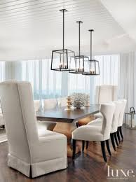 dining room lighting fixtures. In This Stunning Dining Room, Three Holly Hunt Light Fixtures Are Suspended Over A Rectangular Room Lighting