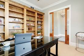 office design home. Modern Home Office With Built-in Shelving, Gray Walls And Carpet Flooring. Design