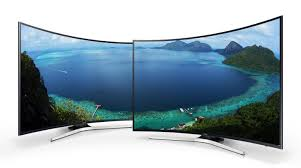 samsung tv uk. two curved samsung tv with beautiful land scape onscreen image. tv uk