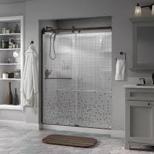 frameless contemporary sliding shower door in bronze with mozaic