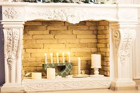 decorative unused fireplace with candles