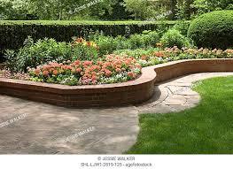 raised brick flower beds stock photos
