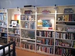 bookshelf lighting. Ikea Bookcase Lighting Lined Up Bookcases Look Like Built Ins And Industrial Clamp Lights . Bookshelf