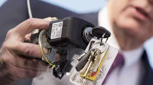 edward markey holds up a faulty general motors ignition switch during a press