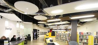 circular and rectangle sound absorbing ceiling rafts in southsea library acoustic solutions office acoustics
