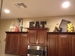 Decorations On Top Of Kitchen Cabinets Gorgeous Adorable How To Decorate Top Of Kitchen Cabinet Decor On Decorating