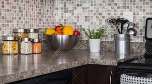Modern Kitchen Countertop Food Ingredients And Green Herbs On Modern Kitchen Countertop