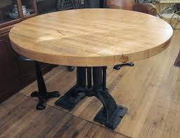 refurbished round butcher block table with heavy cast iron base in excellent condition for in