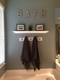 light grey wall color with white shelves and elegant tub using unique vintage bathroom wall decor and ideas