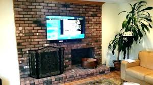 mounting tv above brick fireplace mounting above fireplace