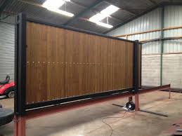 steel frame sliding gate with tongue and groove infill pre automated prior to deliver to