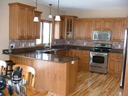 Kitchen With Oak Cabinets And Stainless Steel Appliances Decorating