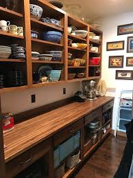 inspiration for a mid sized timeless galley laminate floor and brown floor kitchen pantry remodel