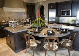 This subtly bespoke kitchen features a standout L-shaped island in dark  stained wood,