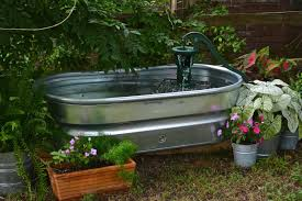 stock tank garden fountain and let s add sprinkles our farmhouse chic fountain