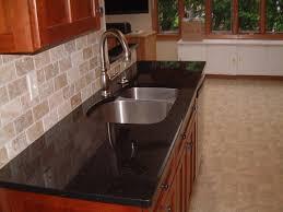 backsplash ideas for black granite countertops. Pleasant Chrome Chimney Hood G Burner And Ceramic Wall White Kitchen Backsplash Over Black Granite Countertops Ideas For O