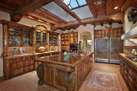Beautiful rustic kitchen with custom cabinetry, red onyx counters and  herringbone pattern brick floors