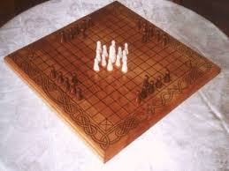 Game With Rocks And Wooden Board The Full History of Board Games The Startup Medium 63