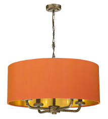 shown in bronze with firefly orange silk shade and gold lining