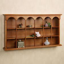 brown high gloss polished wall mounted display storage having three tier open shelf with stick ornament