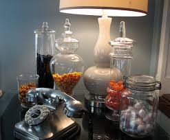 Enticing Table With Small Accessories On Glass Vase As Good Halloween House  Decor