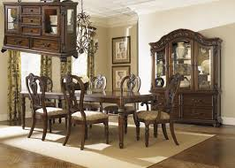 dining room furniture stores yorkshire. dining room solid mahogany dark brown with a satin sheen hand carving four corner leg table extends out to 9 feet.10 matching carved chairs, two arm chairs furniture stores yorkshire m