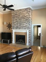 Gorgeous fireplace facing made with polyurethane panels that mimic the look  of real stacked stone.