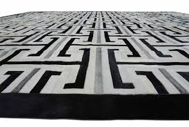 black gray and white patchwork cowhide rug design