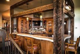 1 tag Rustic Bar with Columns, Pendant Light, Hardwood floors, Built-in  bookshelf,