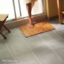 replacing bathroom tile floor imposing on intended for how to lay install a ceramic in the