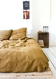 cover 3 ways to bring warmth to your home with autumnal colours linen beddinglinen yellow linen duvet