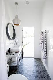 pool bathroom. Koa-house_pool-bathroom-gatsby-tile-white-cb2-crescent- Pool Bathroom M