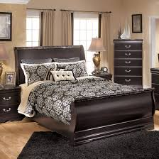 sleigh bedroom furniture.  sleigh dark wood sleigh bed by ashley furniture to bedroom
