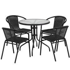 28 round glass metal table with black rattan edging and 4 black rattan stack chairs