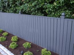 Pressure treated, bespoke timber fence painted with Farrow & Ball colours