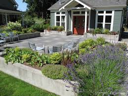 a simple raised border around this concrete paver patio creates a welcoming space for this community center
