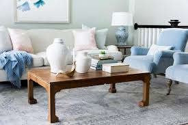 blue velvet roll arm chairs with chinoiserie coffee table