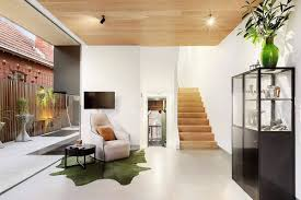 view in gallery living room and the outdoors become one thanks to the sliding glass door system