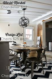 our world market metal orb chandelier might be my new favorite decor item in our house isn t it lovely world market curly has it d at 119