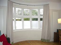 curved curtain rod for bay window unique how to hang rods inside inspirations 13