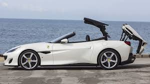 For the portofino, ferrari spent time camouflaging the rear deck's height with shapes and colors, though the space required by that top still makes this a the interior is heavily redesigned with a busy but attractive dashboard. 2019 Ferrari Portofino Convertible White