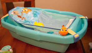 finding nemo baby bathtub gift basket from disney then i grabbed some adorable flannel blankets unwrapped them and rolled around bath s rol