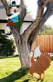 thanksgiving pilgrim treed by turkey