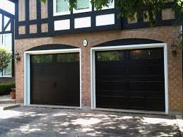 black garage doorsElegant House with Black Garage Doors  Camer Design