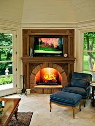 smlf corner fireplace with tv mounted above electric stand menards small living room ideas