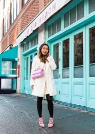 layersofchic all white outfit white fur coat winter style