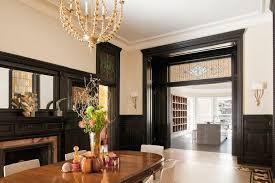 dark stained wood trim white crown whitewashed floors
