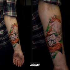 фото татуировки лиса в стиле цветная татуировки на руке