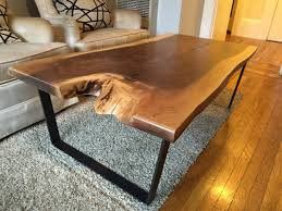 live edge black walnut slab coffee table live edges on both sides natural satin finish supported by four custom made steel rod hairpin legs