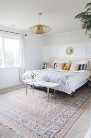 pretty pale bedroom with oriental rug in pinks
